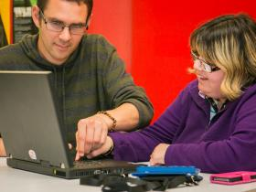 Photo of deafblind person using the internet