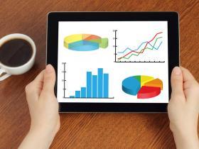 Photo of iPad showing website statistics