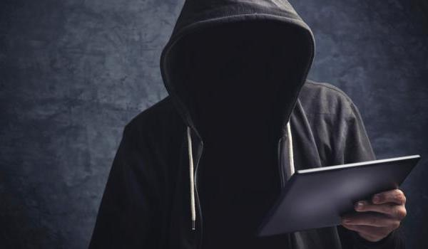 Photo of a hacker with laptop