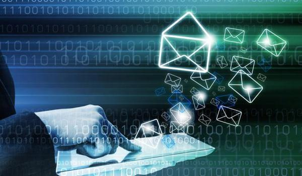 Image of person sending emails