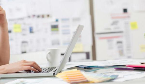 Photo of woman designing website